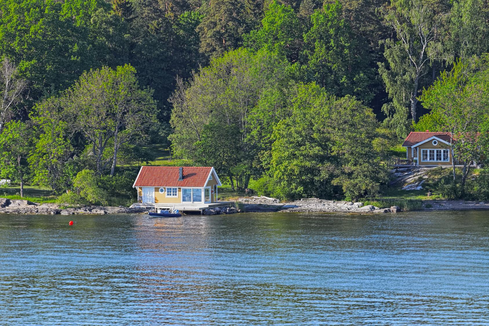 Wooden cabin on rocky shore of Stockholm archipelago, Sweden