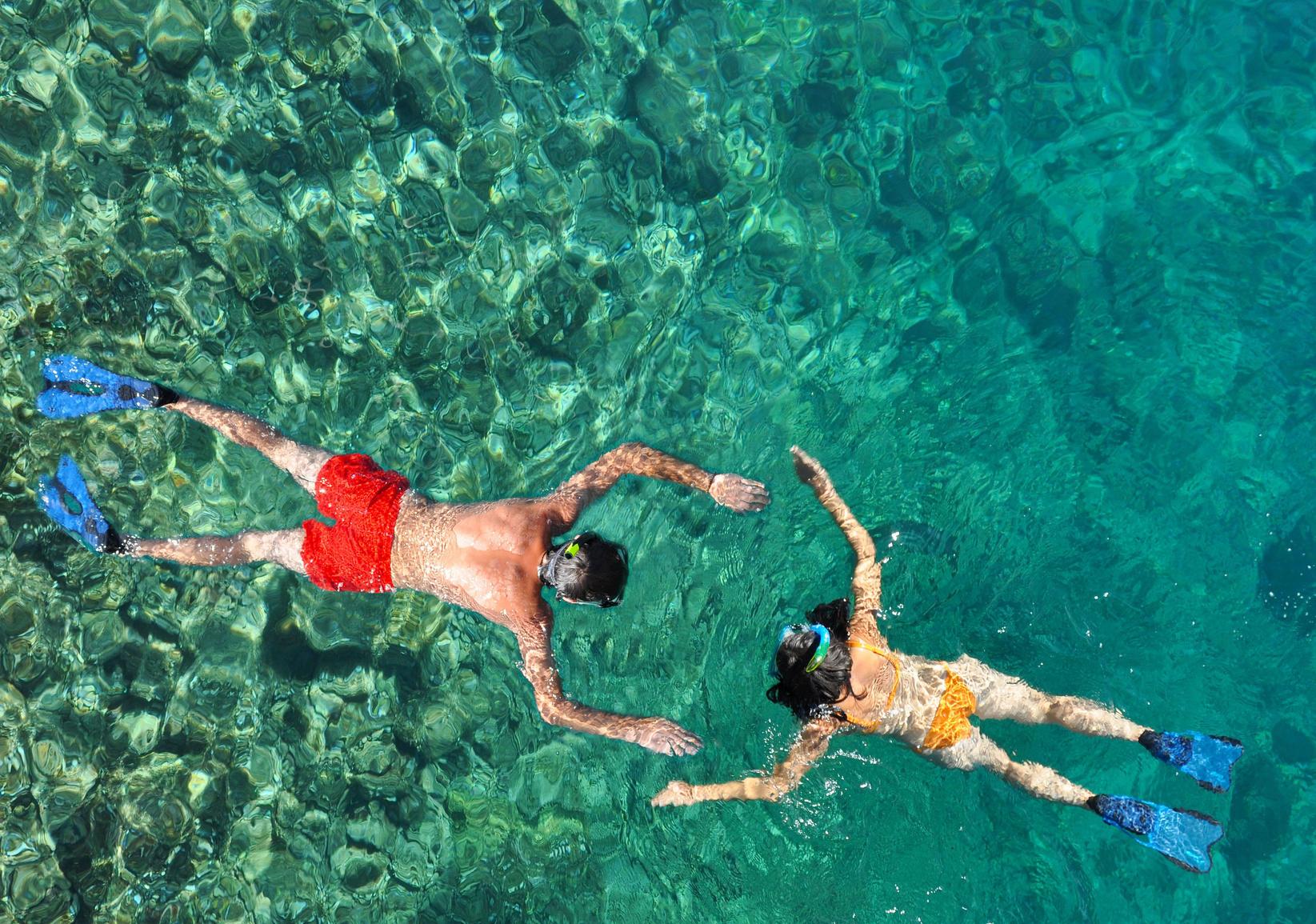 Romantic couple snorkeling in the sea